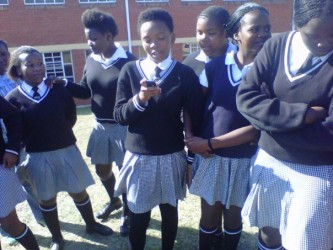 Girls sharing SMS HIV Prevention message