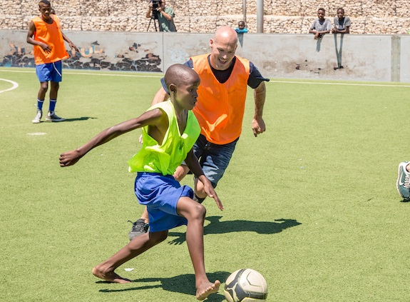 Freddie L. with GRS participants playing soccer