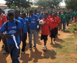 Teams arrive for the VCT tournament at the Bauleni Basic School in Lusaka, Zambia.