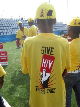 "A skillz participant wears one of our new ""Give HIV the Red Card"" t-shirts and hats."