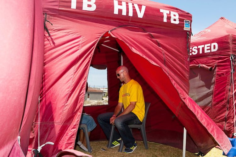 Former South African national team star Matthew Booth gets an HIV test at a GRS event.