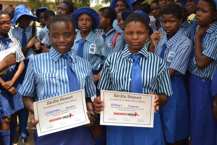 Girls in Zimbabwe at their Grassroot Soccer graduation.