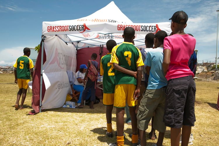 Youth line up for free HIV Counseling and Testing at a Grassroot Soccer testing tournament in South Africa.